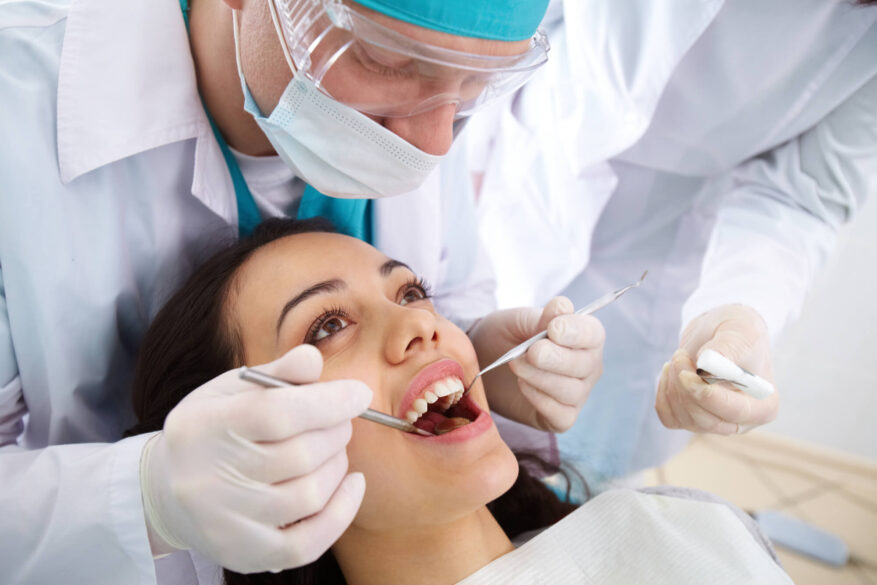 dentist in Tamiami doing dental checkup to a female patient